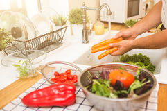 Man Washes Vegetables Before Eating Royalty Free Stock Images