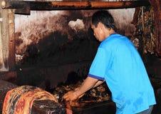 Man washing batik stock photos