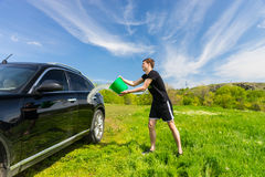 Man Washing Black Car in Green Field Stock Photography