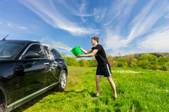 Man Washing Black Car in Green Field Stock Photos