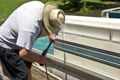 Man Washing Boat stock image