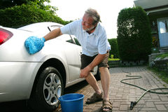 Man washing car Stock Photo