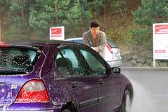 Man washing car Stock Images