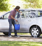 Man Washing Car In Drive Royalty Free Stock Image