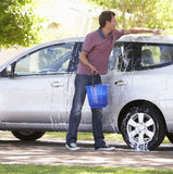 Man Washing Car In Drive Stock Photo