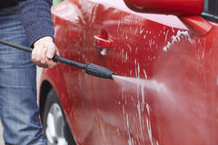 Man Washing Car With Pressure Washer Royalty Free Stock Photo