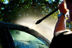 Man washing car Royalty Free Stock Images