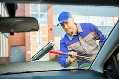 Man Washing Car Window With Mop Stock Photo