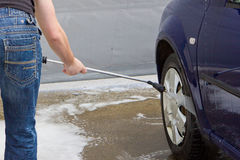 Man washing car Stock Photos