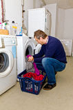 Man washing clothes Royalty Free Stock Photo