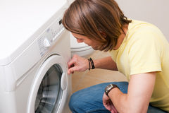 Man washing clothes with machine Royalty Free Stock Images