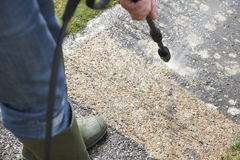 Man Washing Concrete Path With Pressure Washer. Man Washes Concrete Path With Pressure Washer stock image