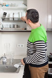 Man washing dishes stock photos