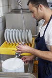 Man washing dishes Royalty Free Stock Image