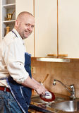 Man washing a dishes Stock Photo