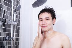 Man washing face in the bathroom Royalty Free Stock Photo