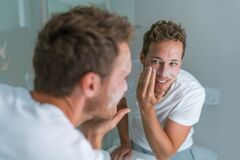 Free Man Washing Face With Soap Scrubbing Exfoliation Mask Facial Treatment Looking In The Mirror. Men Taking Care Of Skin Royalty Free Stock Images - 191845499