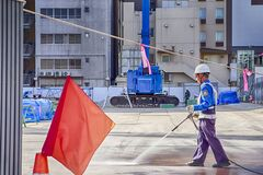 Free Man Washing Floor With Sprayer On Construction Site In Okayama , Japan, At November 4, 2019 Royalty Free Stock Images - 170653649