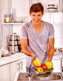 Man washing fruit at kitchen Royalty Free Stock Image