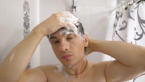 Man washing hair in the shower. Man taking shower at morning and washing hair stock video