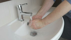 Man washing hands in the bathroom stock video