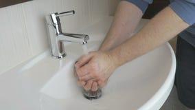 Man washing hands in the bathroom stock footage