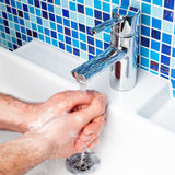 Man washing hands Royalty Free Stock Photos