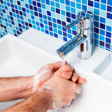Man washing hands Stock Photo