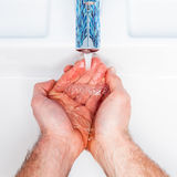 Man washing hands Royalty Free Stock Photography