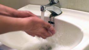 Man washing hands stock footage