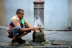 Man washing hands - Rome Italy Stock Photography