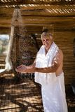 Man washing hands from shower in cottage during safari vacation Royalty Free Stock Images