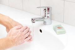 Man washing. Hands with soap Royalty Free Stock Images
