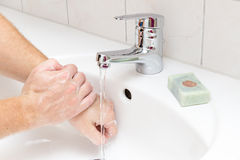 Man washing. Hands with soap Stock Photos