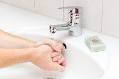 Man washing. Hands with soap Stock Photography