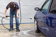 Man washing his car at self-service station Royalty Free Stock Photo
