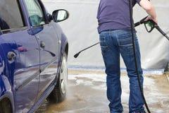 Man washing his car at self-service station Royalty Free Stock Image