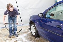 Man washing his car at self-service station Royalty Free Stock Photography