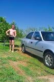 Man washing his car under pressure stock photo