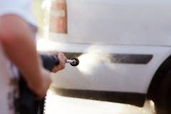 Man washing his car Royalty Free Stock Image