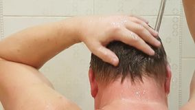 The man is washing his hair. Health stock footage