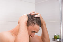 Man washing his hair in shower Royalty Free Stock Photo