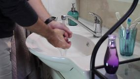 The man is washing his hands stock footage