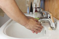 Man washing his hands in the sink. Hygiene Stock Photo