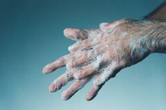Man washing his hands with soap. Coronavirus transmitted through a hands