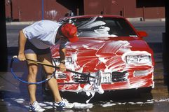 A man washing his red car in Barstow, California Royalty Free Stock Photo