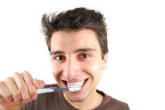 Man washing his teeth Stock Image