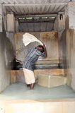 Man washing laundry at Fort Cochin on India Stock Photo