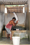 Man washing laundry at Fort Cochin on India Stock Photos