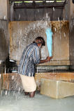 Man washing laundry at Fort Cochin on India. Fort Cochin, India - 16 January 2015: Man washing laundry at Fort Cochin on India stock image